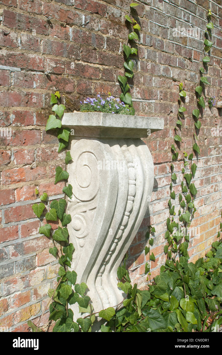 Ornamental Garden Architecture With Antique Brick Wall Purple Flowers And  Ivy   Stock Image