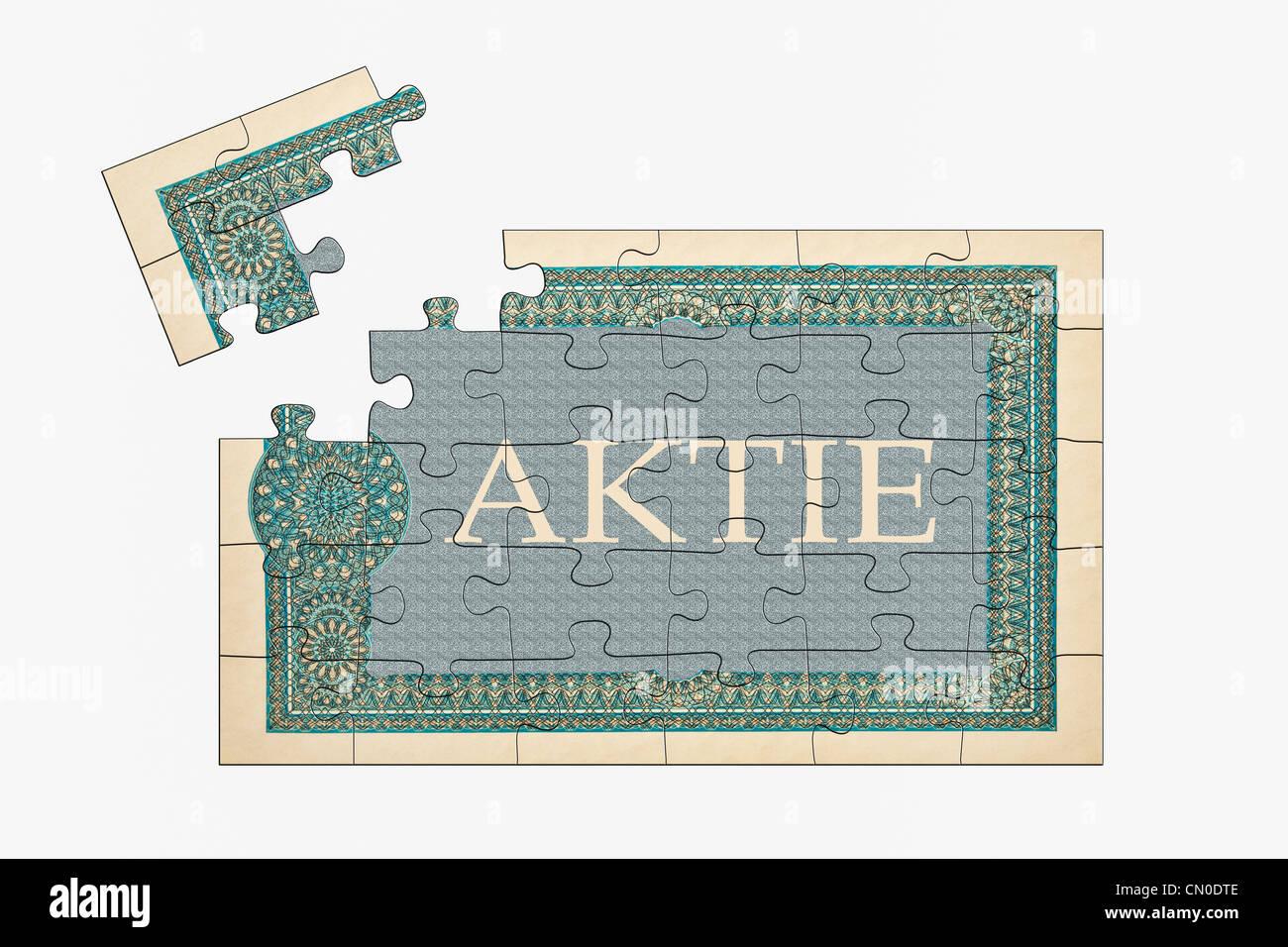 Puzzle: Teilansicht einer alter deutschen Aktie   Puzzle: partial view of an old German share - Stock Image