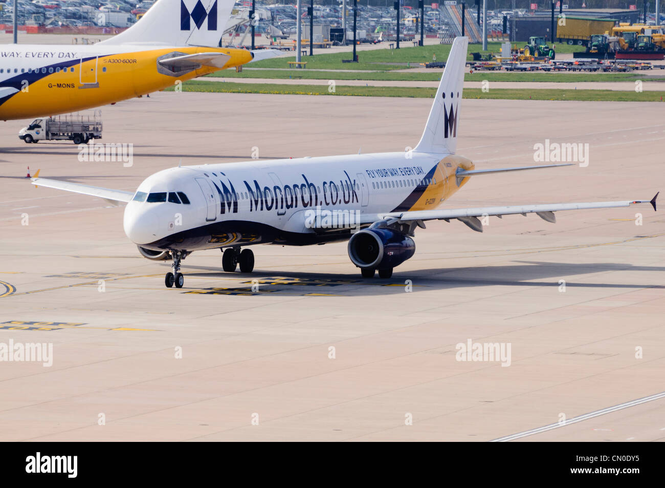 Monarch Airlines A321 taxiing on an airport apron. - Stock Image