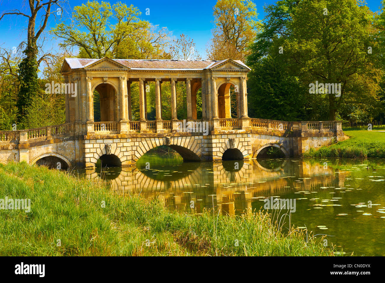 Palladian  Style bridge in the landscape gardens of Stowe House, the former residence of the Dukes of Buckingham - Stock Image