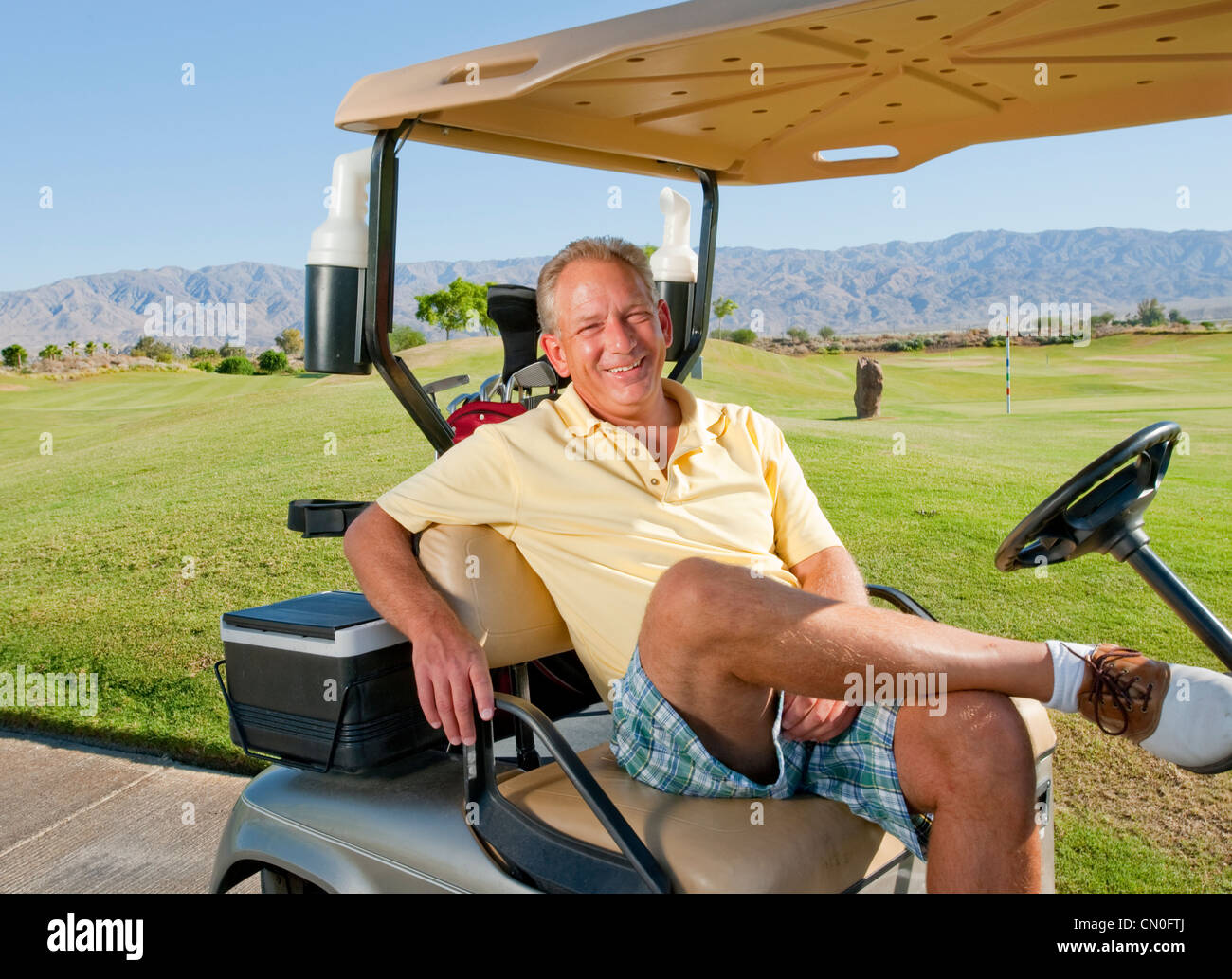 Man Relaxing In Golf Cart Stock Photos & Man Relaxing In Golf Cart on exciting golf, natural golf, lazy golf, peaceful golf, cute golf, captain kangaroo golf, playing golf,