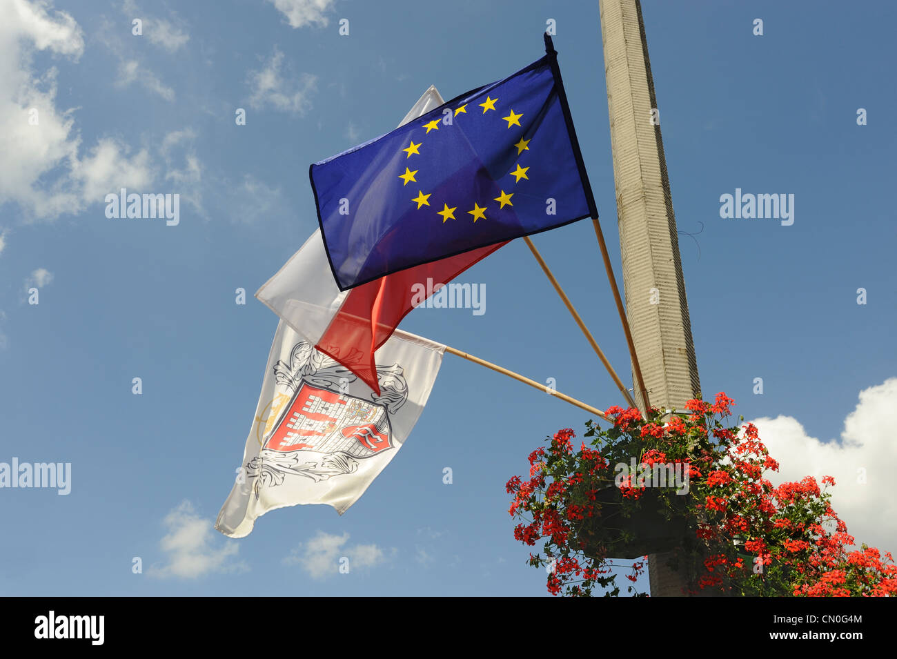 National, EU and the city of Radom flags on a lamp post, Radom, Poland - Stock Image