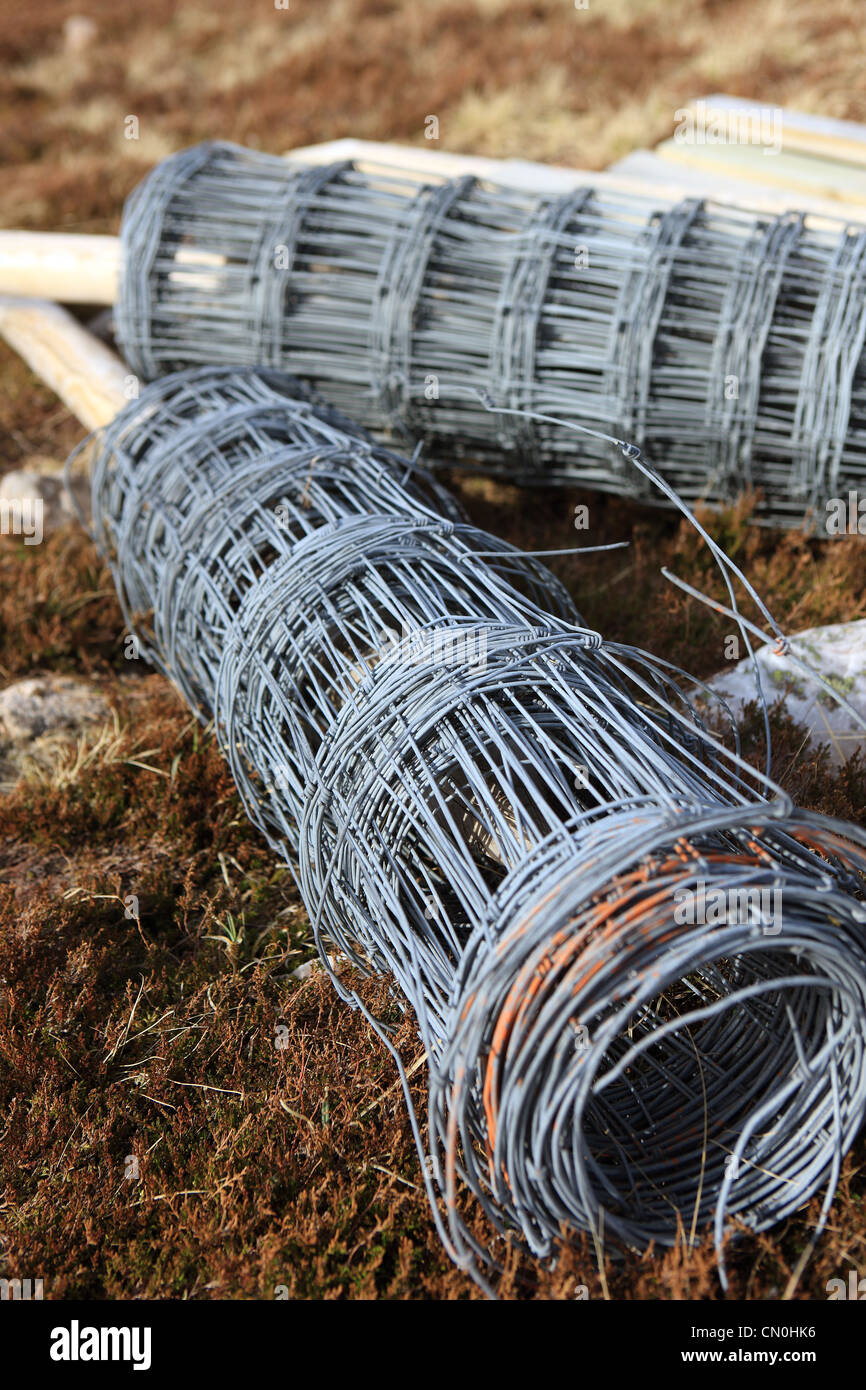 Rolls Of Wire Fencing Lying On A Hillside For Fencing Fields Stock Photo Alamy