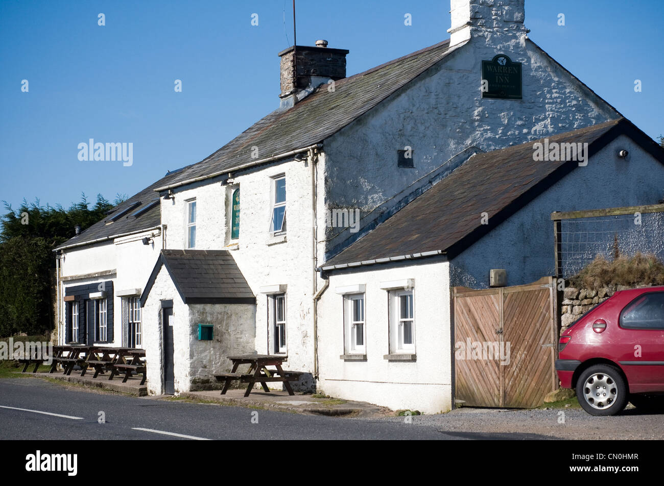 Warren House Inn,the most famous Inn on Dartmoor.  The Warren House Inn is near the Bronze age settlement remains - Stock Image