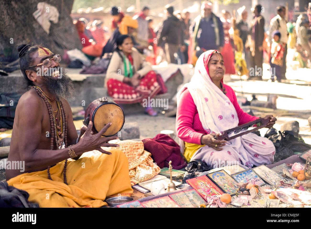 Sadhu busking for alms during annual mela (festival) at Ridi baazar , Nepal . - Stock Image