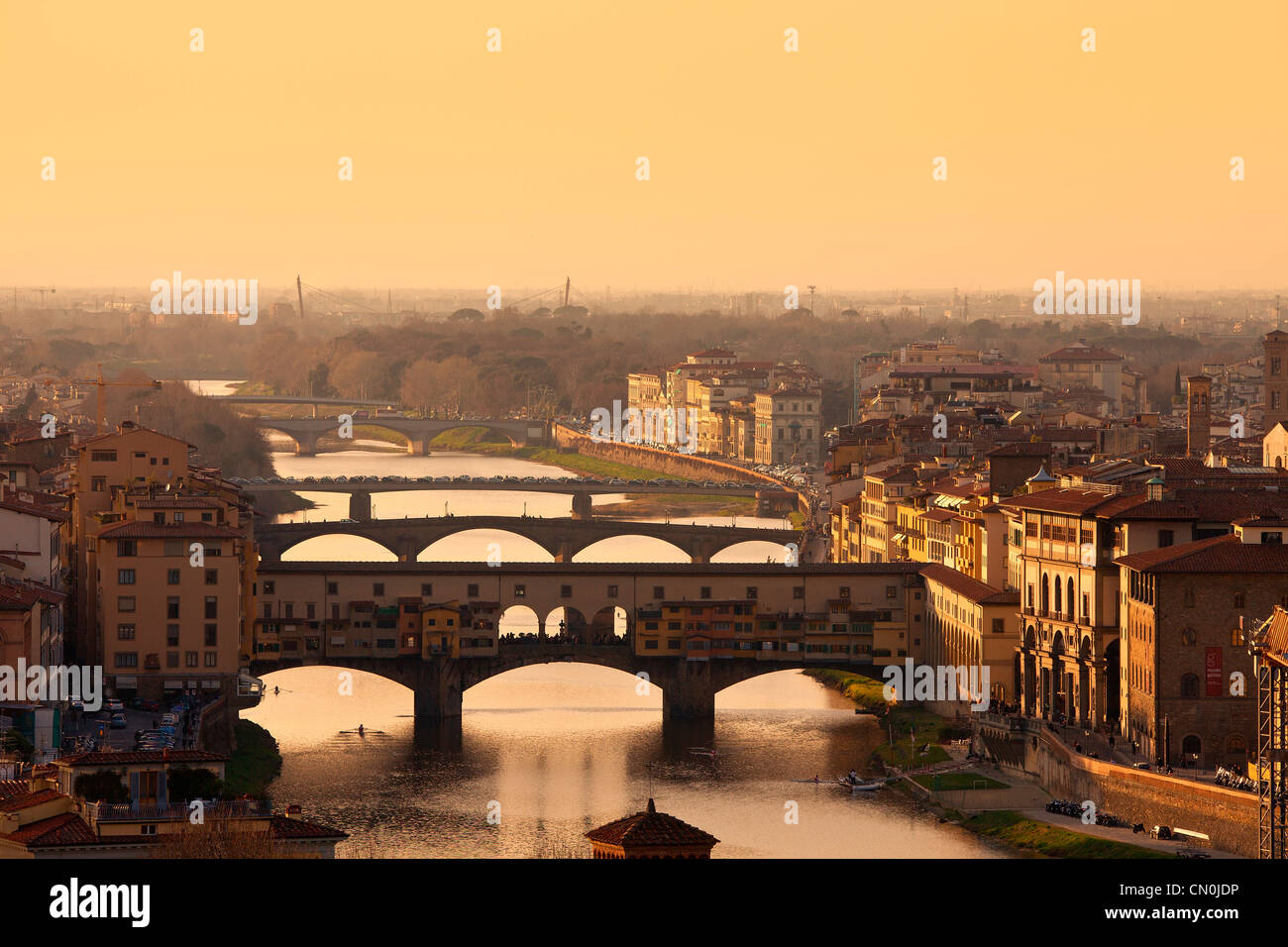 Europe, Italy, Florence, Ponte Vecchio over the Arno River at Sunset - Stock Image