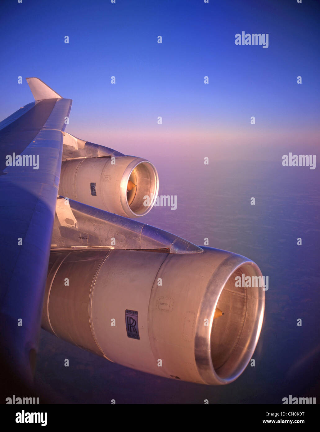View of wing and engines from inside Boeing 747-400 aircraft - Stock Image