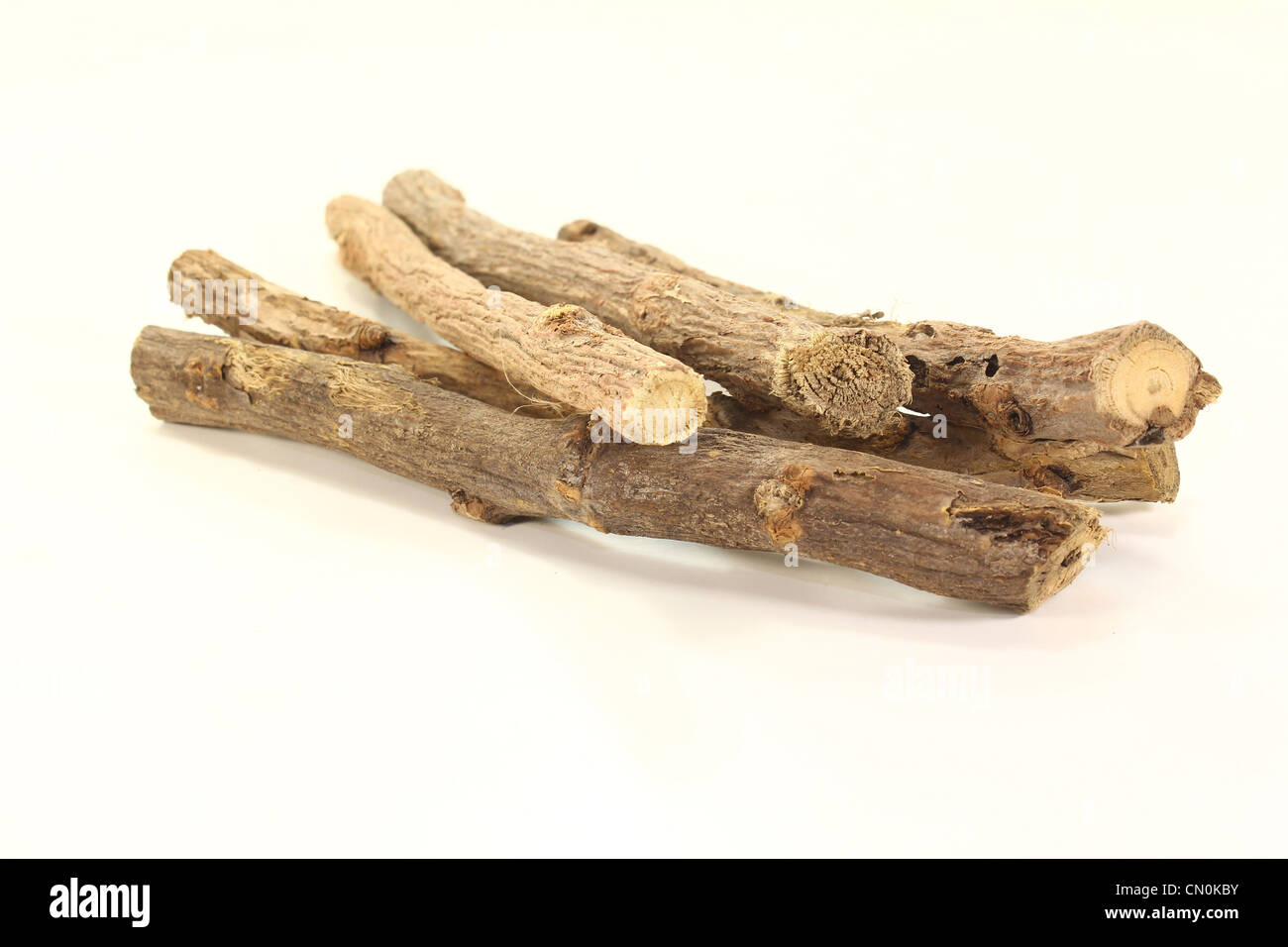 liquorice root with liquorice flavoured on a bright background - Stock Image