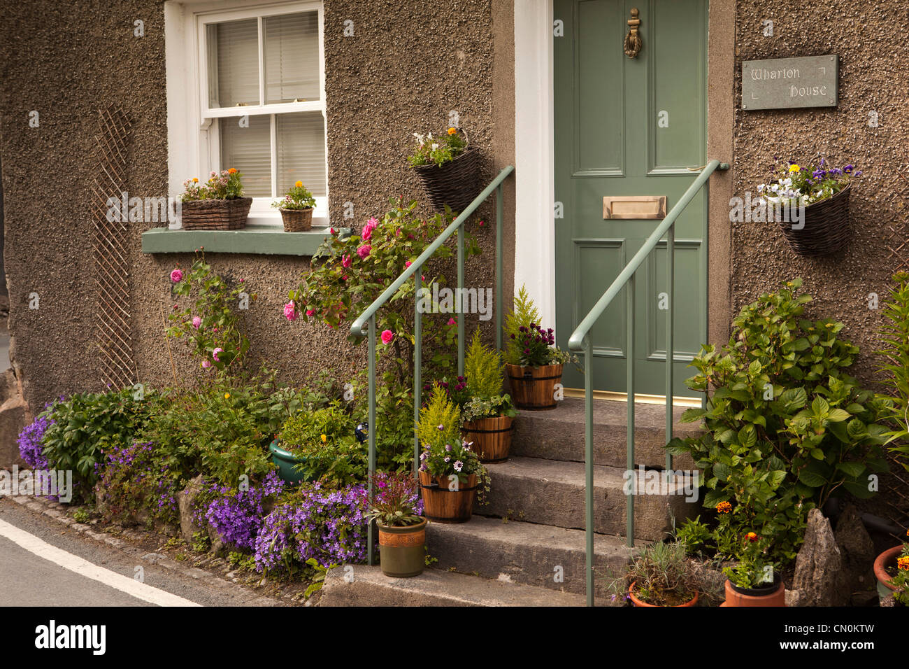 UK, Cumbria, Cartmel very small front garden in flower ...