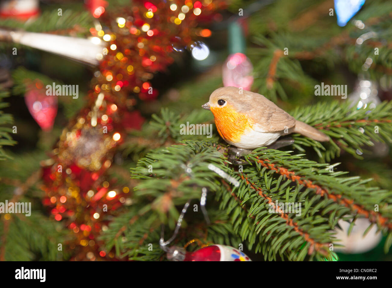Robin decoration on christmas tree Stock Photo