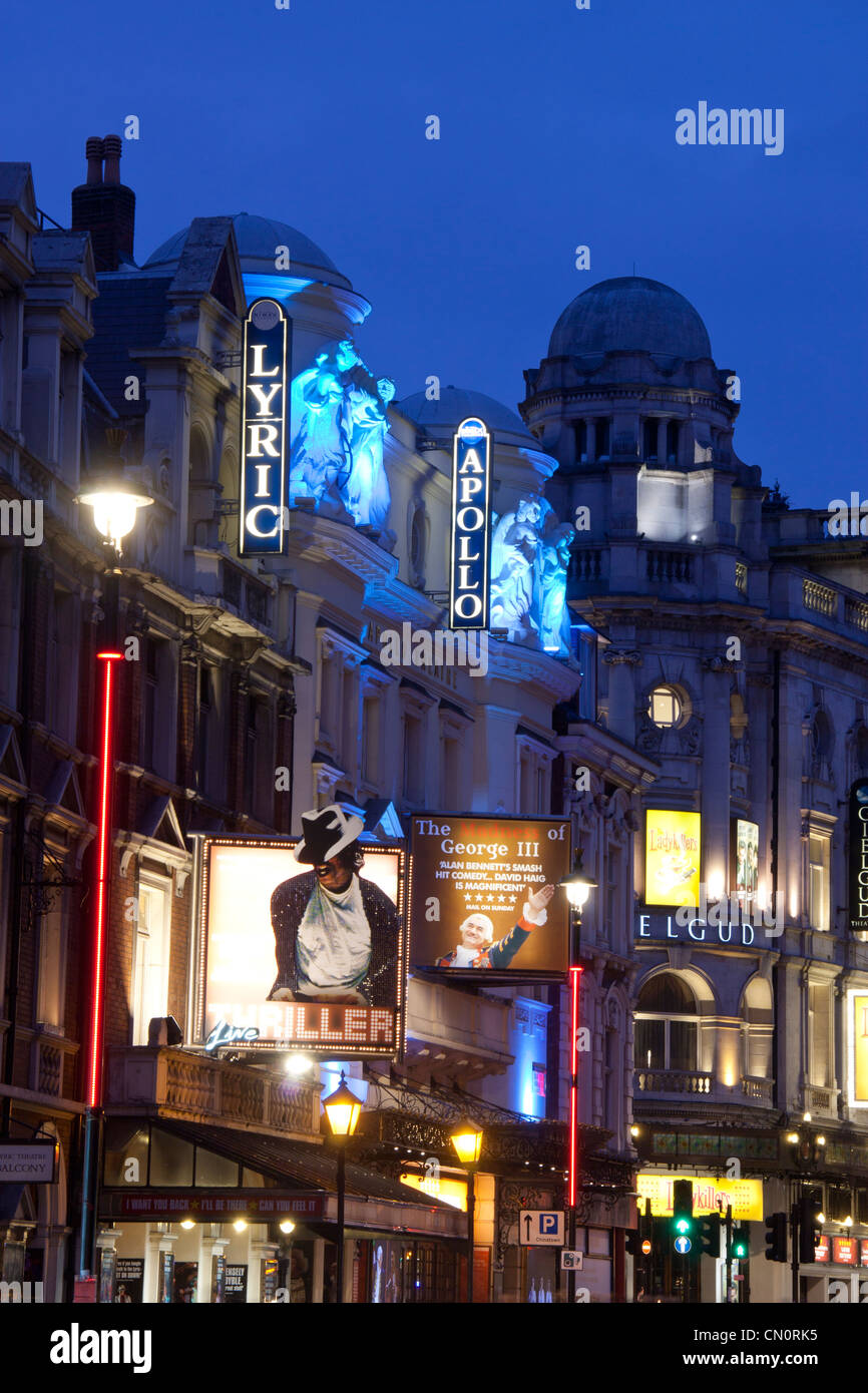 London Theatreland Lyric, Apollo and Gielgud Theatres Shaftesbury Avenue at night with traffic trails London England - Stock Image