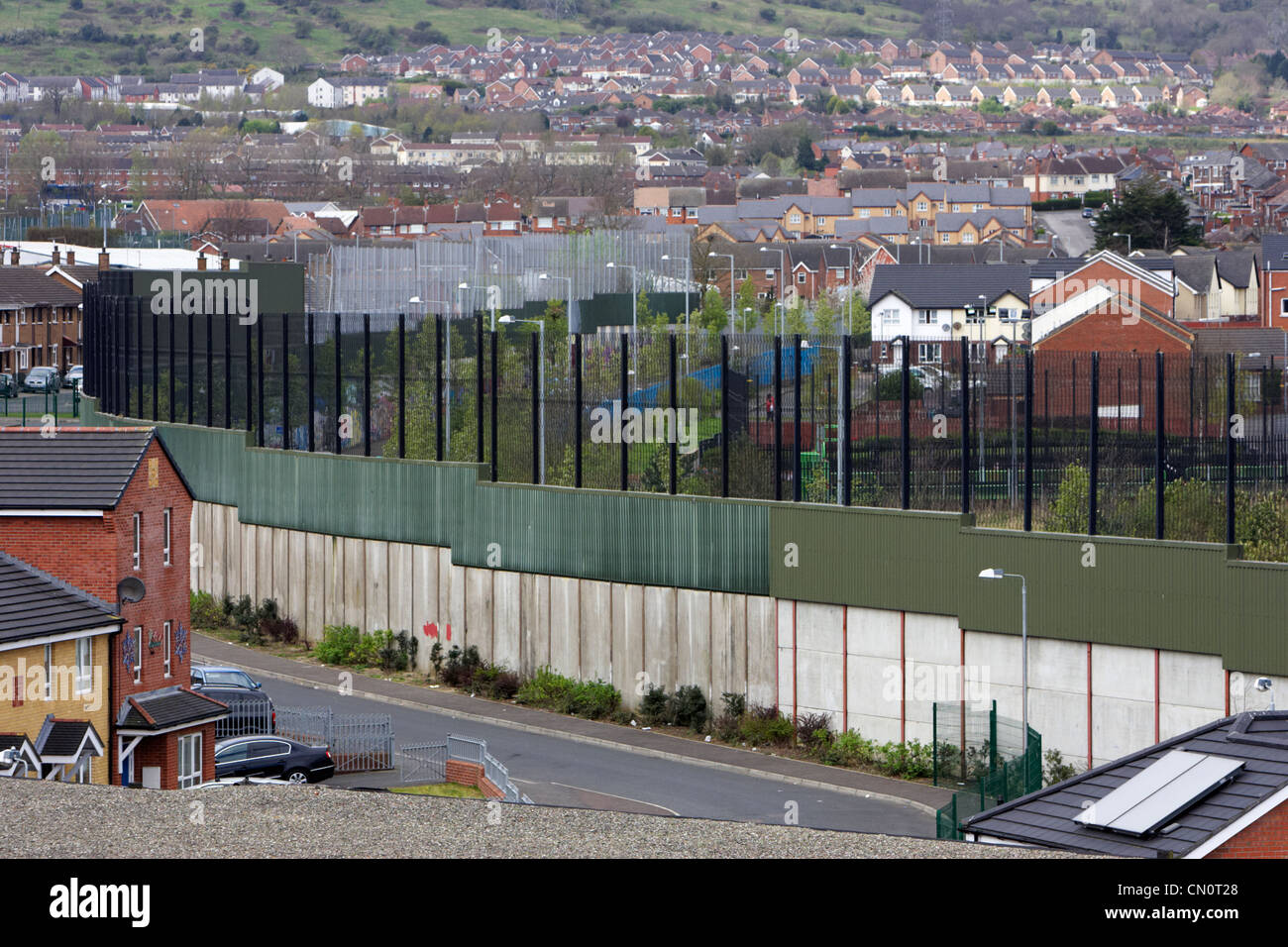 the peace line wall separating the lower falls and shankill areas of west Belfast Northern Ireland UK - Stock Image