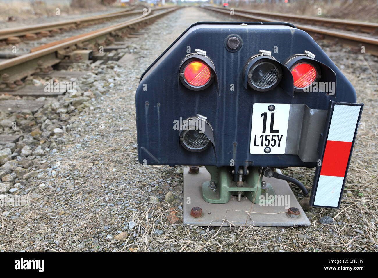 Electric rail signal with red lights in the port of Bremen, Germany - Stock Image