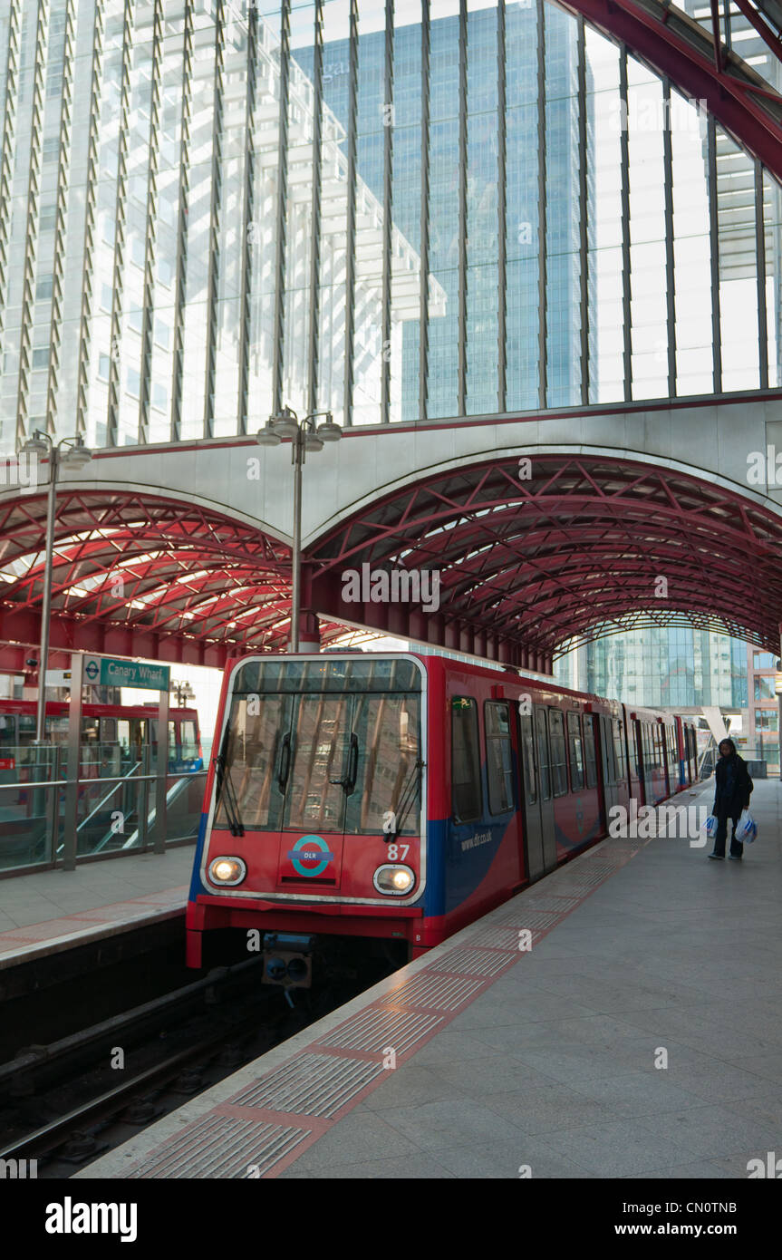 Docklands Light Railway DLR station with train at Canary Wharf. London. England. - Stock Image