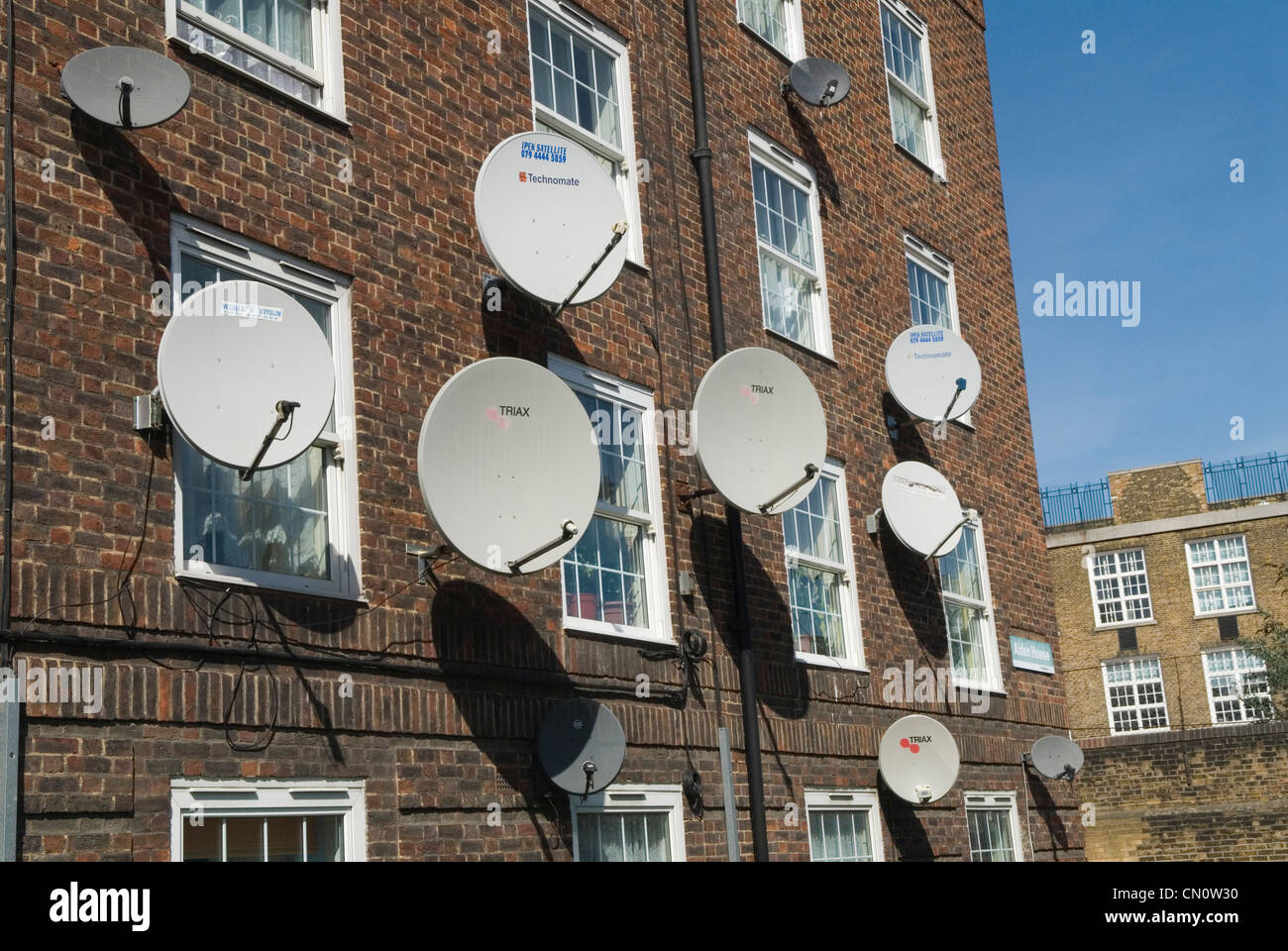 Satellite disk exterior local authority council property London UK HOMER SYKES - Stock Image