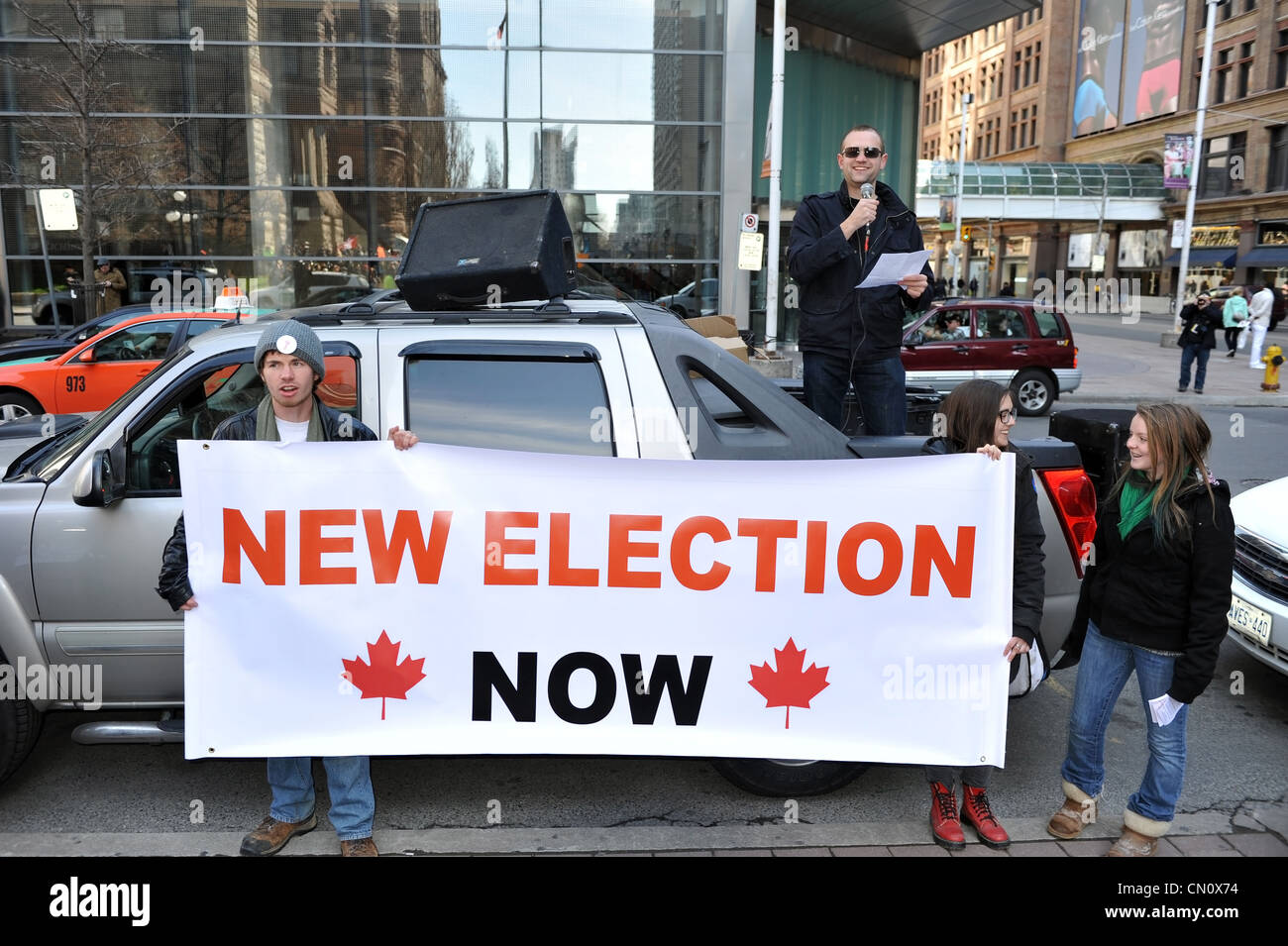 Protesters gathered in Toronto to protest the election fraud committed by the Conservatives in the last Canadian - Stock Image