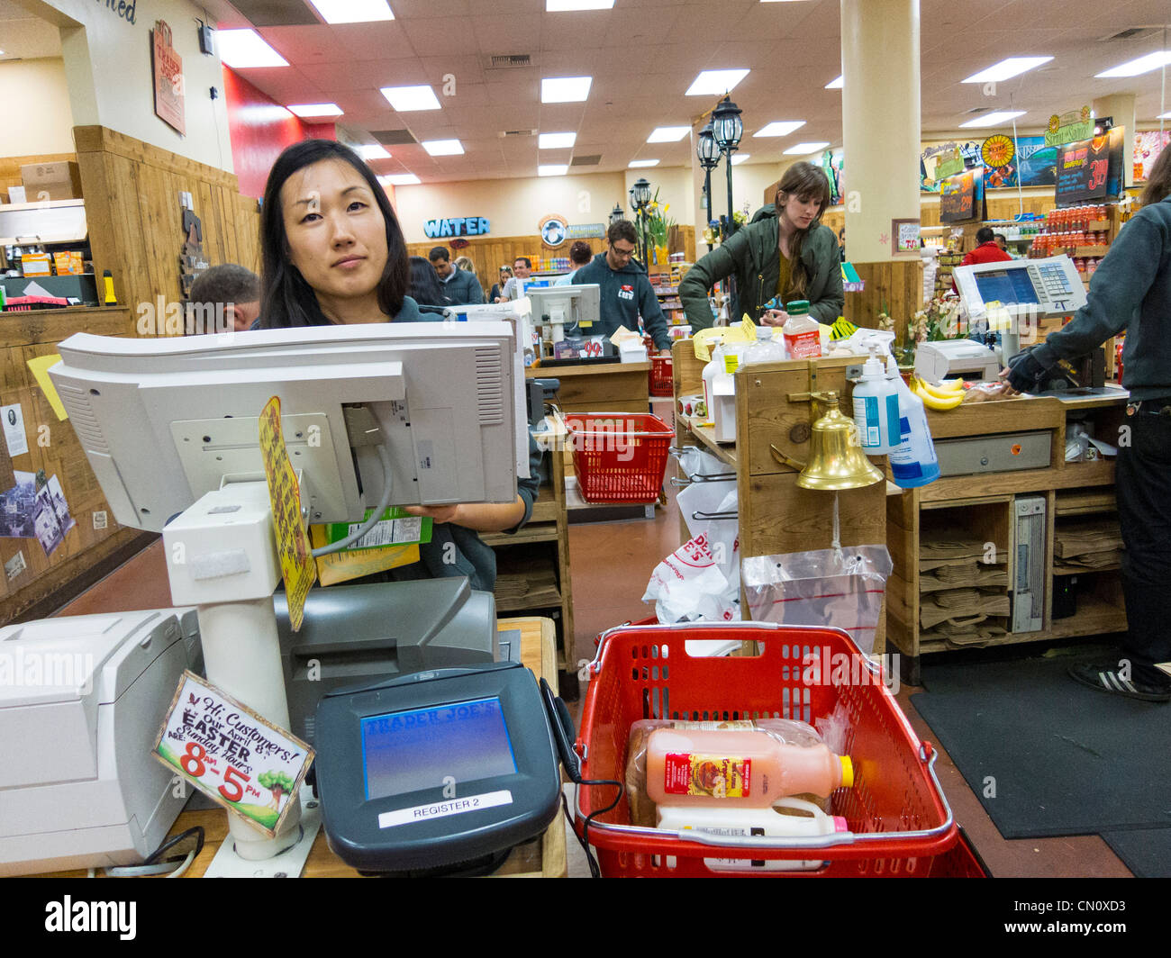 checkout clerk at Trader Joe's, Philadelphia, USA - Stock Image