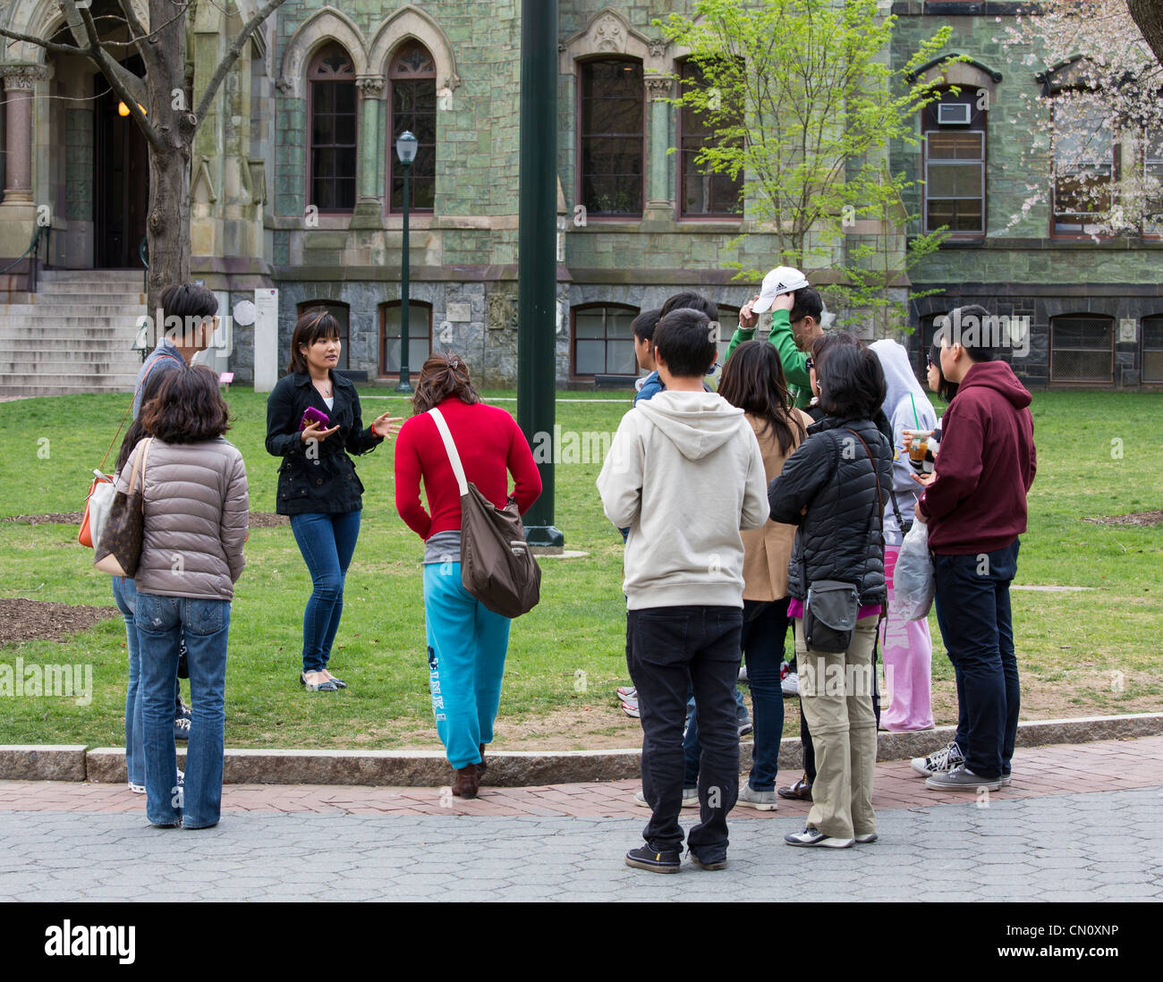 prospective students on student-led admissions office tour of University of Pennsylvania campus, Philadelphia, USA - Stock Image