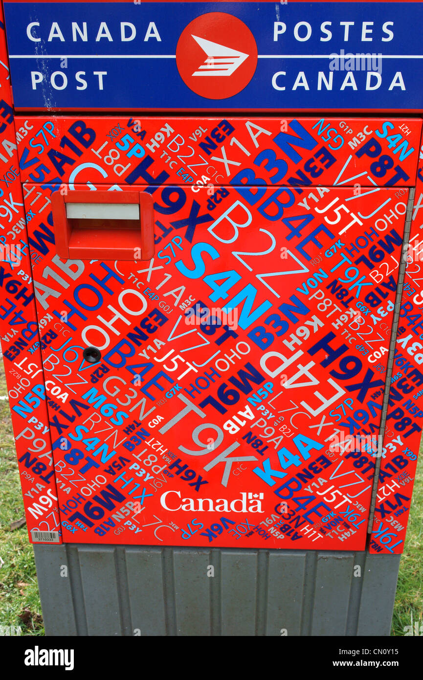 Mailbox decorated Canadian postal codes, Vancouver, British Columbia, Canada - Stock Image