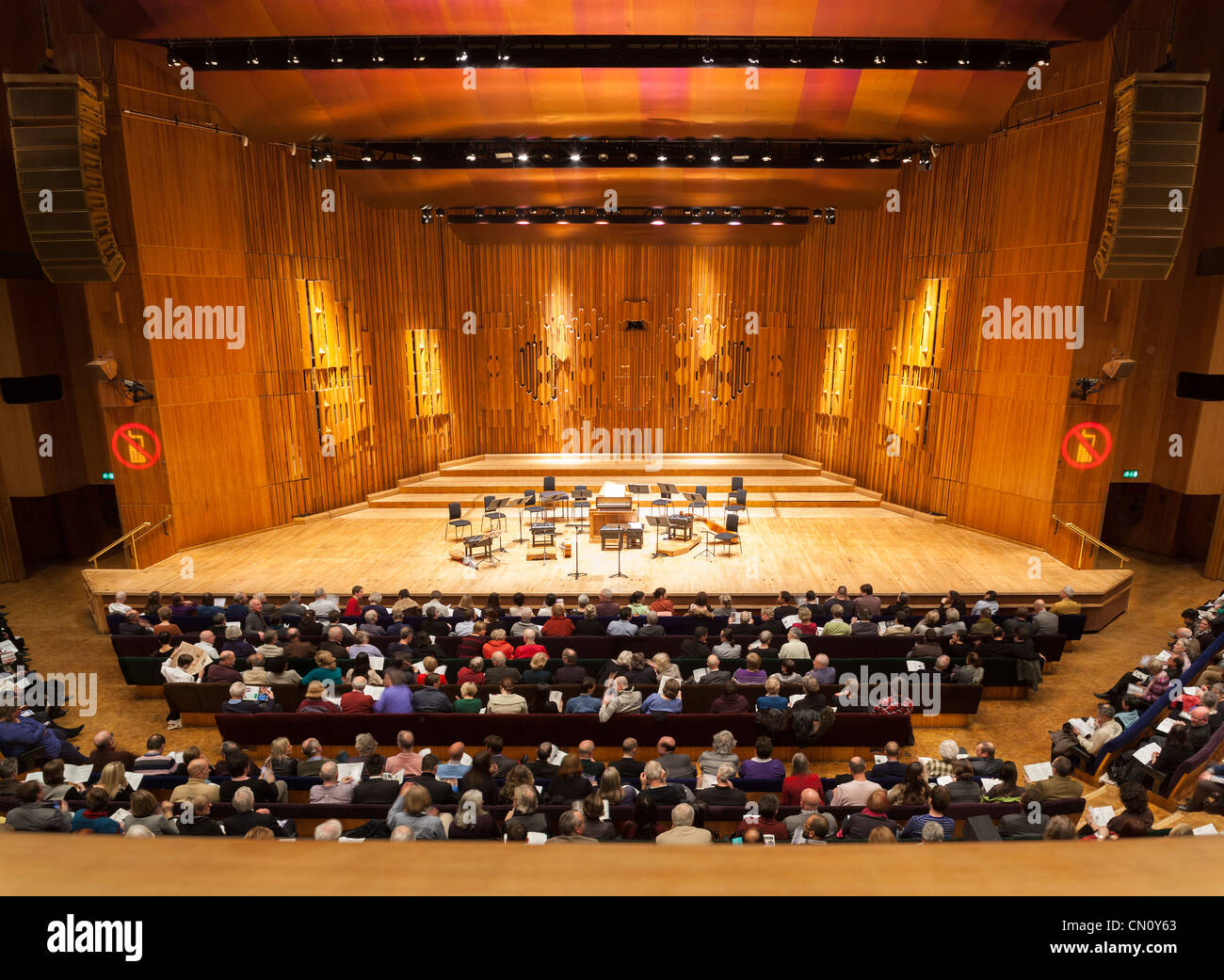 Empty music stage of the Barbican Centre Concert Hall Theatre Theater Auditorium London. With audience public visitors - Stock Image