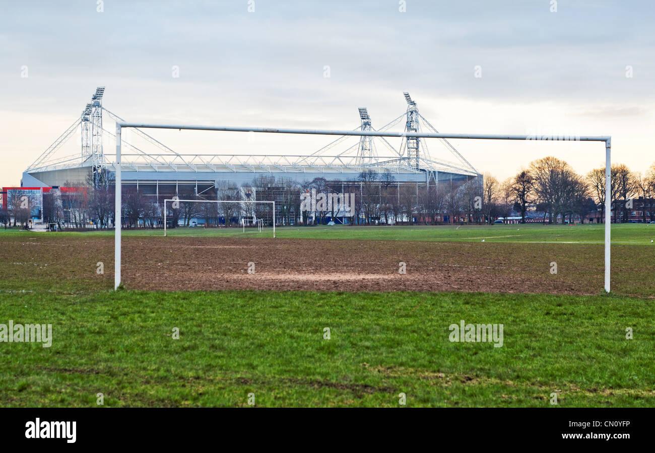 Lancashire UK, Preston North End Football Stadium winter sun sinking over amateur and professional soccer football - Stock Image