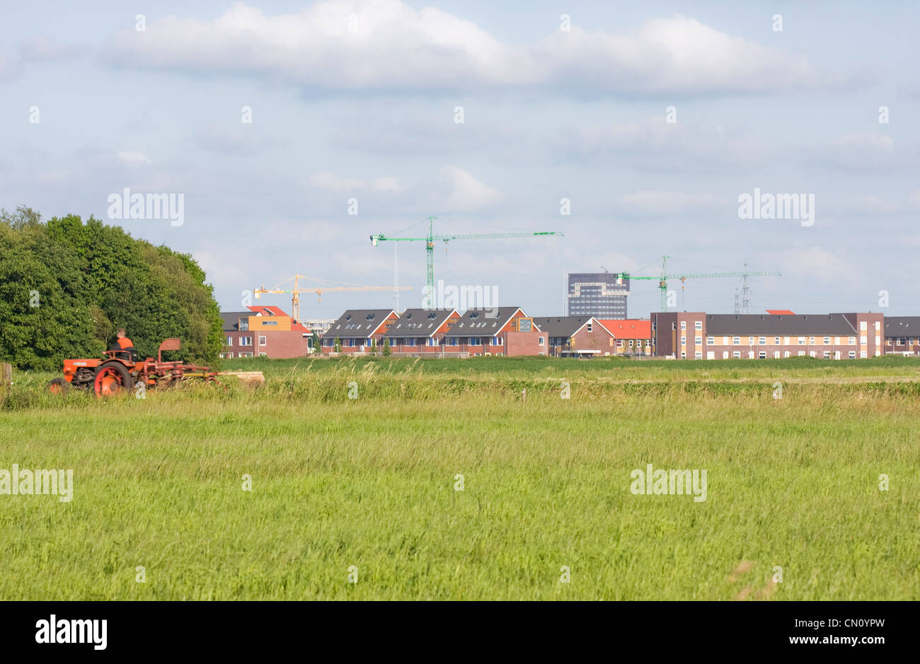 Urbanization: the city is growing, absorbing the rural area. - Stock Image