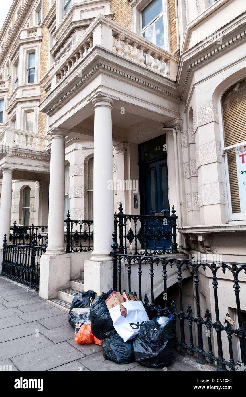 Rubbish sacks on the street outside a house in London, UK - Stock Image