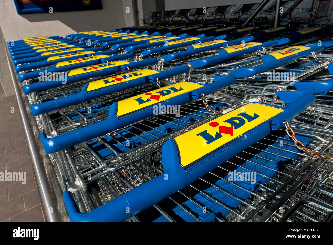 Shopping trolleys at Lidl - Stock Image