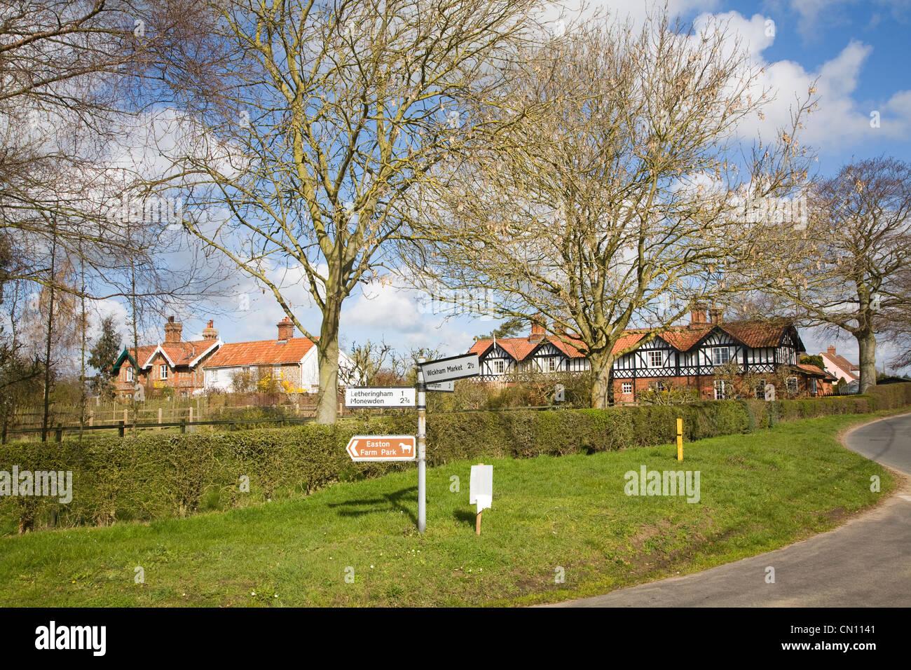 Pretty leafless tree village houses Easton, Suffolk, England - Stock Image