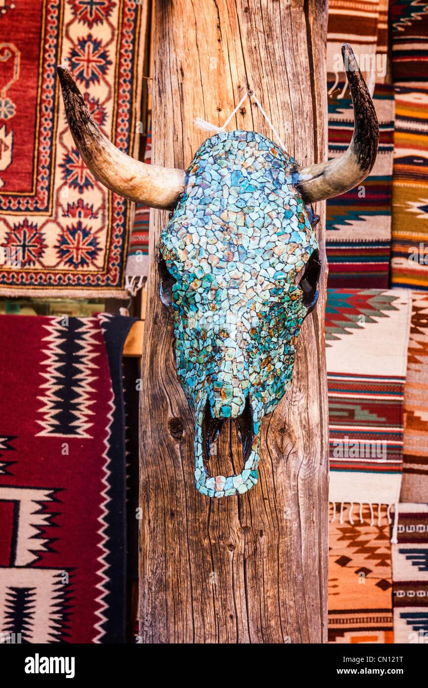 Mosaic cattle skull native indian rugs Santa Fe - Stock Image
