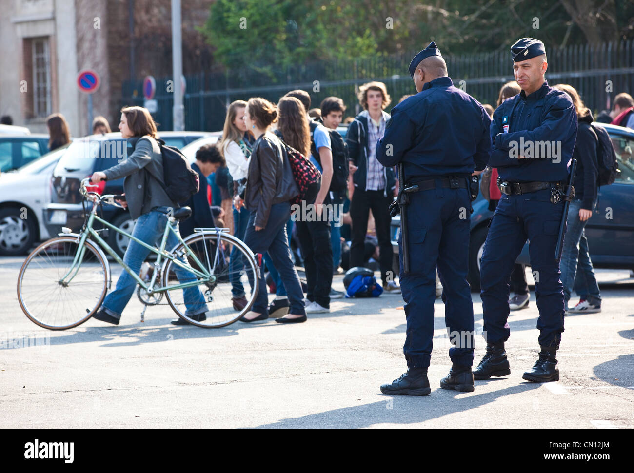 French Police Nationale patrolling the streets outside the Lycée Ozenne high school, in the centre of Toulouse, Stock Photo
