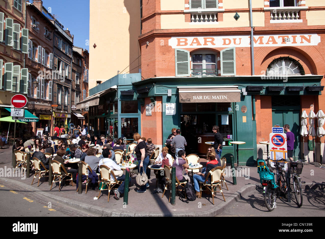 People sitting outside at Bar du Matin, Toulouse, South of France Stock Photo