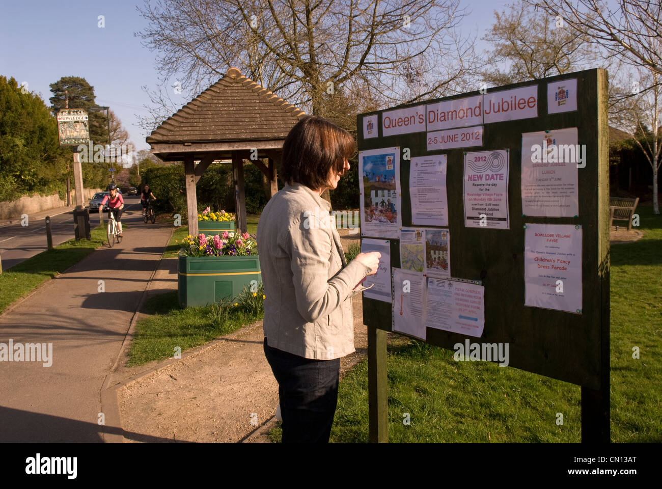 Local resident persuing noticeboard in village of Rowledge concerning Queen's Diamond Jubilee Celebrations in - Stock Image