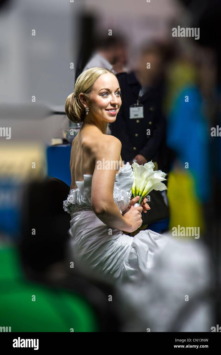 Beautiful female model posing for photographer at Focus on imaging camera show NEC 2012 Birmingham England - Stock Image