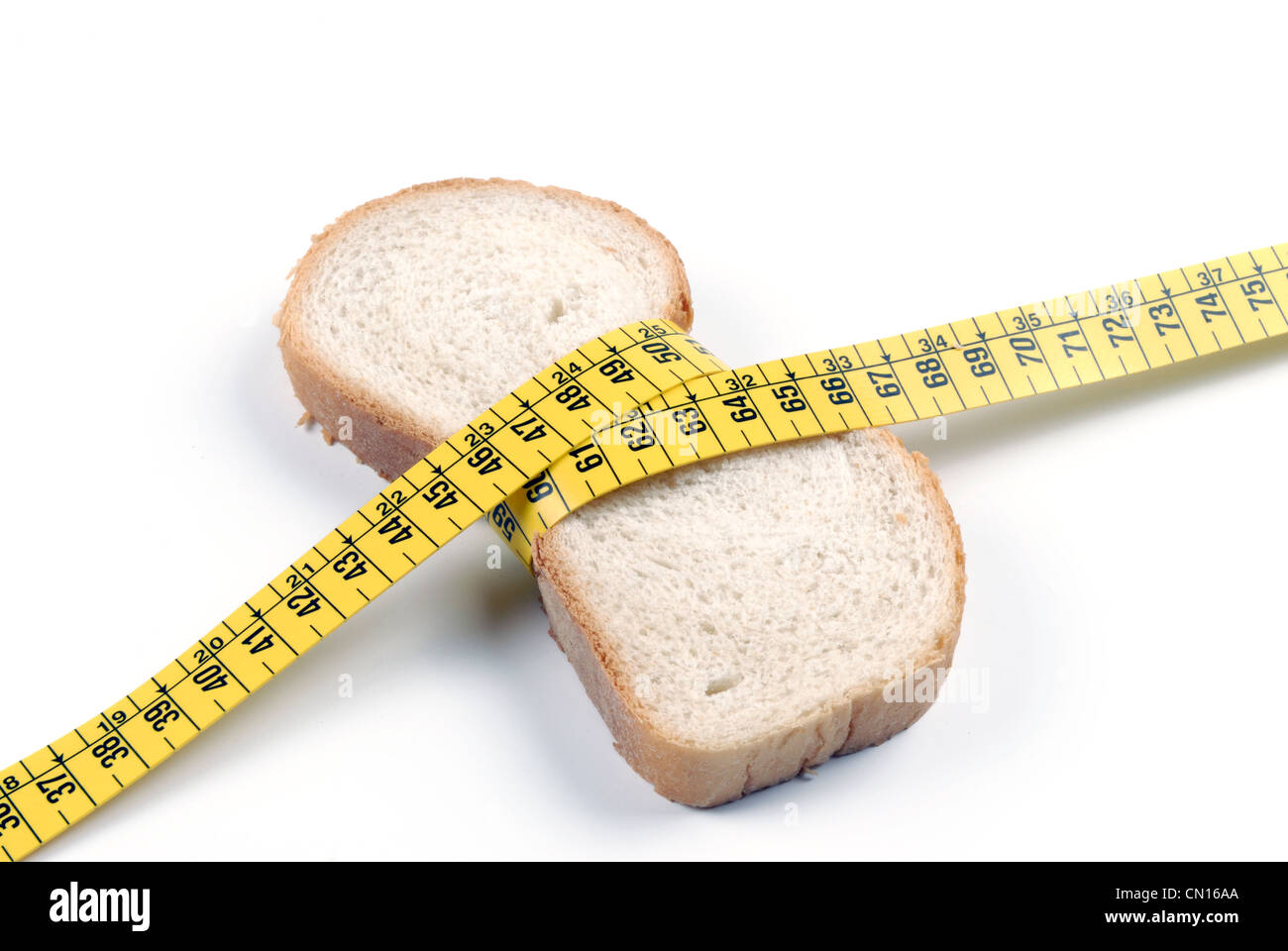Toast with metric tape - Stock Image