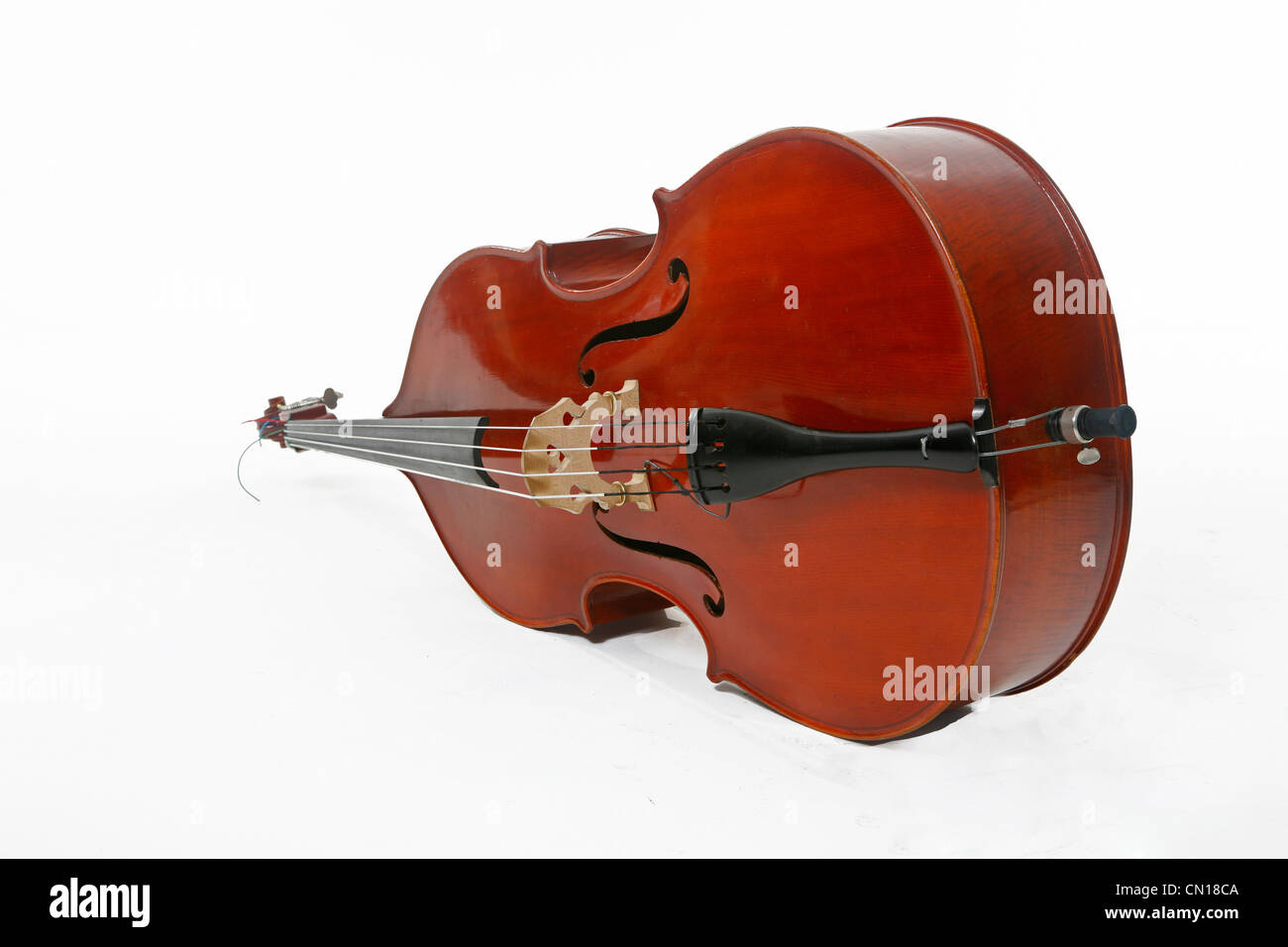 A double bass lying down- white background - cutout Stock Photo