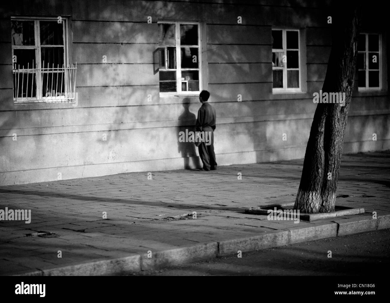 Man in the street in Pyongyang, North Korea - Stock Image