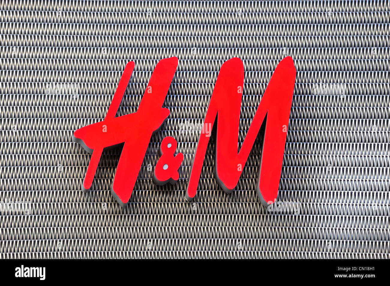 Sign with H&M logo of clothes shop - Stock Image