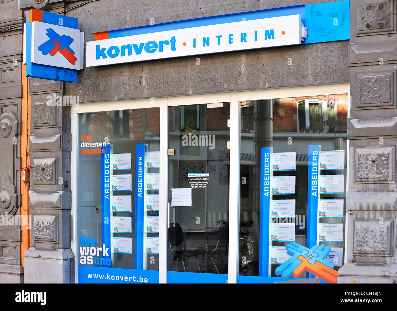 Signboard with logo for temporary employment agency Konvert Interim, Flanders, Belgium - Stock Image
