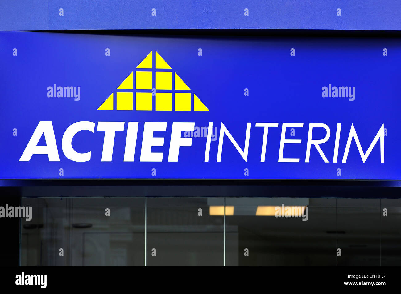 Signboard with logo for temporary employment agency Actief Interim, Flanders, Belgium - Stock Image