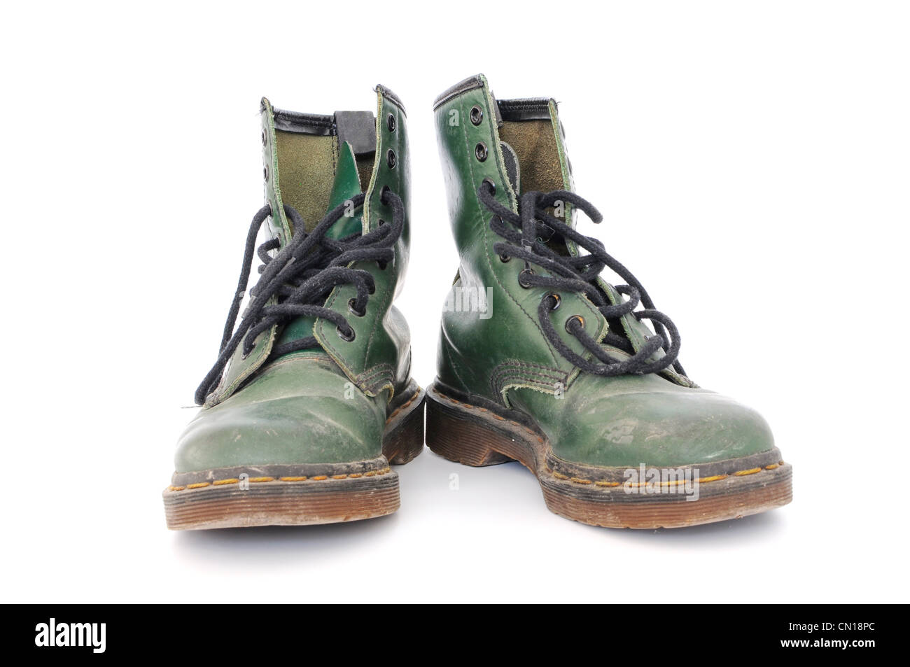 Pair of dirty green worn out shoes - Stock Image