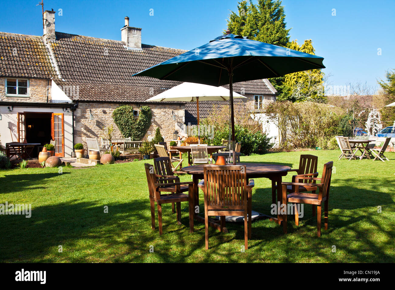 Pub garden of a typical English country village pub or inn in Wiltshire, England, UK - Stock Image