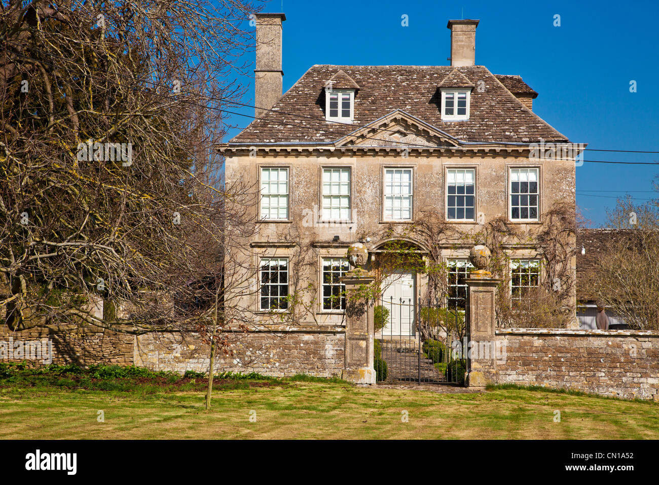 An imposing early 18th century English country manor house in Wiltshire, England, UK - Stock Image