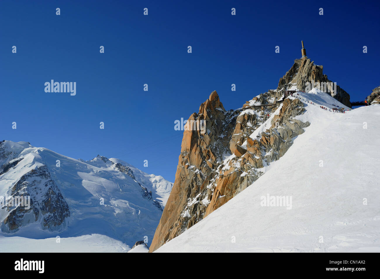 The summit of Aiguille du Midi with Mont Blanc to the left. - Stock Image