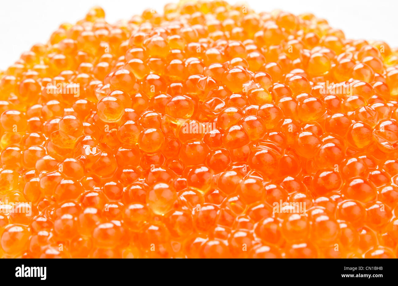 Red salmon caviar isolated on a white background - Stock Image