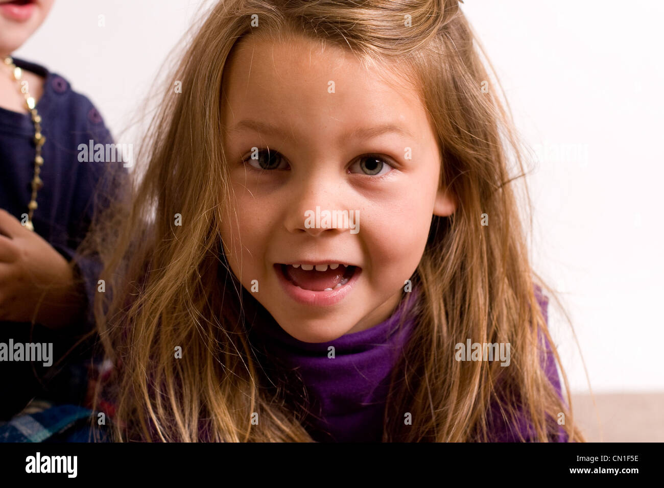 Pretty 5 year old girl going to say something - Stock Image