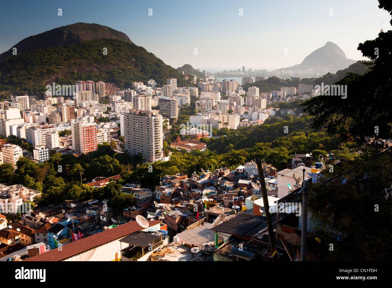 Botafogo quarter and Rodrigo de Freitas Lagoon seen from Favela Santa Marta Rio de Janeiro Brazil poverty and middle - Stock Image