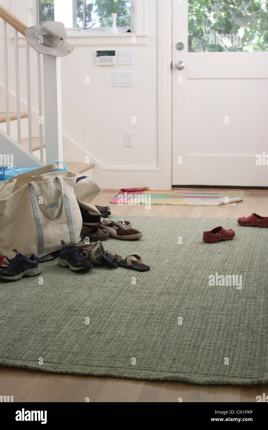Shoes on Floor of Foyer - Stock Image