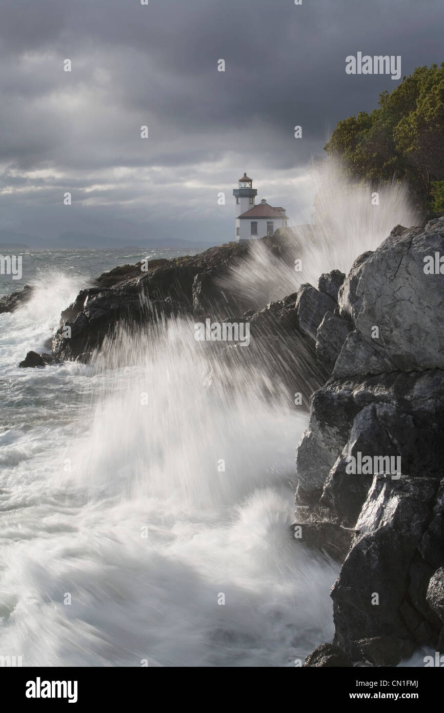 Light House and Rocky Shore 2 - Stock Image