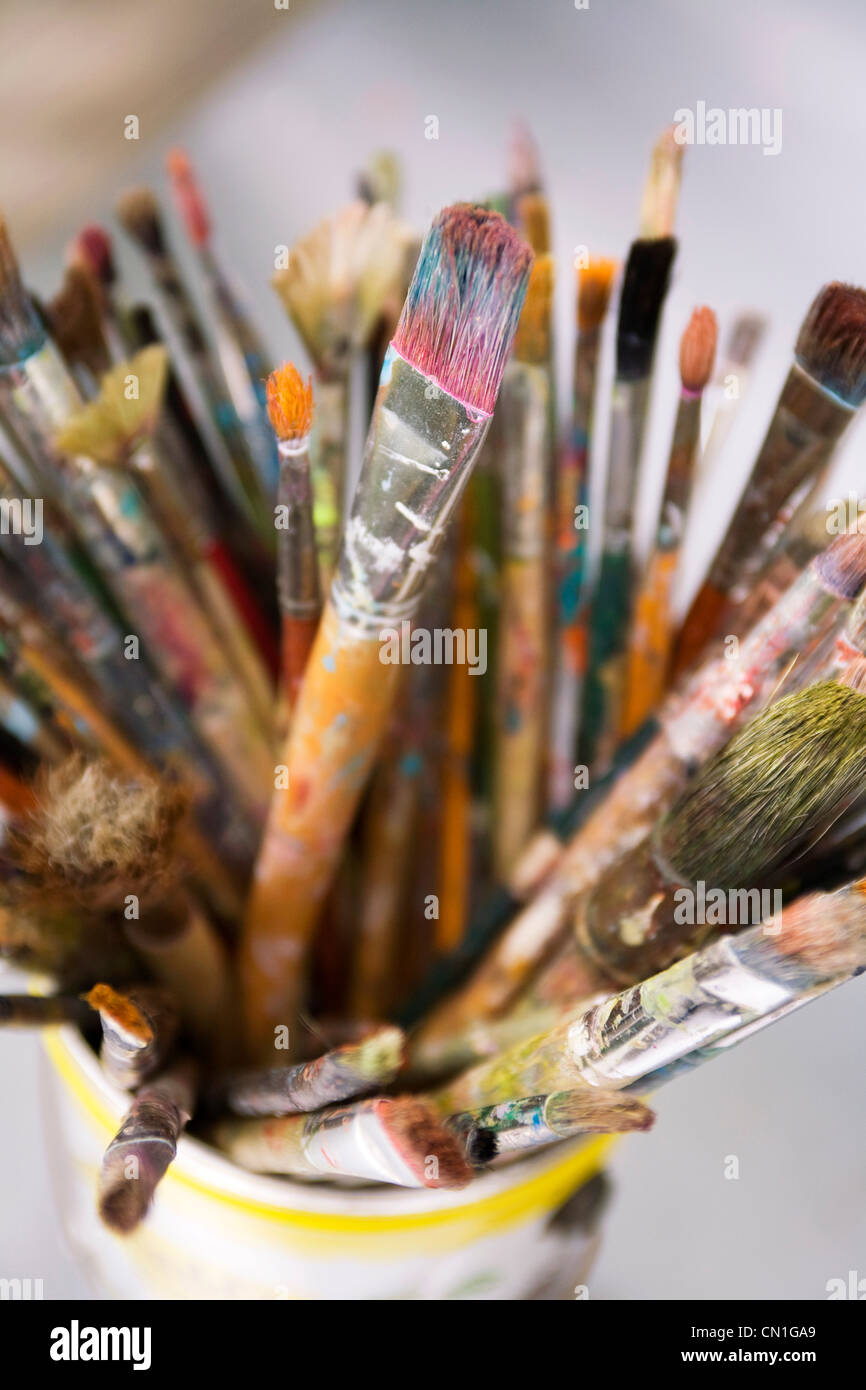 Used Paintbrushes in a Can - Stock Image